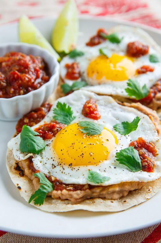 Huevos Rancheros~* | fried tortilla, refried beans mixed w/enchilada sauce, Salsa Rachera (Roast 1 pound plum tomatoes, 2 serrano/jalapeno chilies, 2 garlic in pan & puree with 1 small onion, 2 garlic, 2T cilantro, salt to taste), guacamole or avocado, sunny-side up eggs.