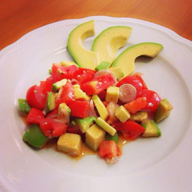 Fresh salad avocado, tomato, onion, lemon, chilly, pepper, salt, oil.