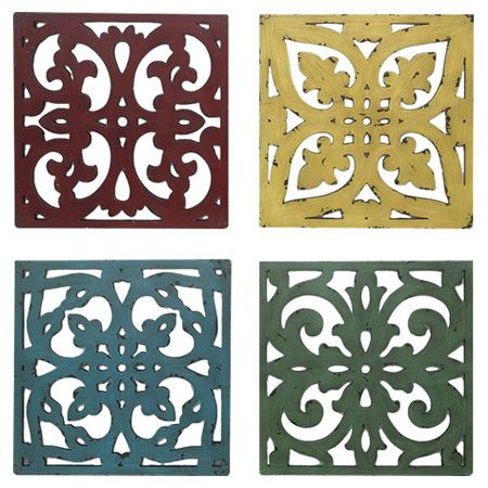 Hang this scrolling openwork wood wall decor in your parlor or kitchen for a colorful pop of rustic style.    Product: Set of 4 wall...