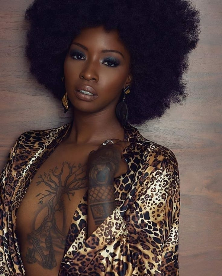Black Woman With Afro Hairstyle And Tattoos