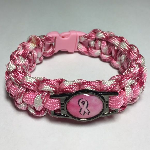 Breast Cancer Awareness Paracord Bracelet! Pink and white Breast Cancer Awareness Paracord Bracelet! Check out our page for many more Paracord bracelet designs! They make for GREAT gifts! Jewelry Bracelets