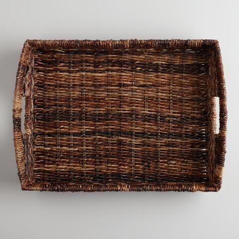 Our Madras Serving Tray is handcrafted of durable, naturally harvested Abaca fiber from the Philippines by basket makers using traditional techniques. The attractive dark colors of this serving tray make it perfect for presenting glassware and spirits for special occasions or everyday use.