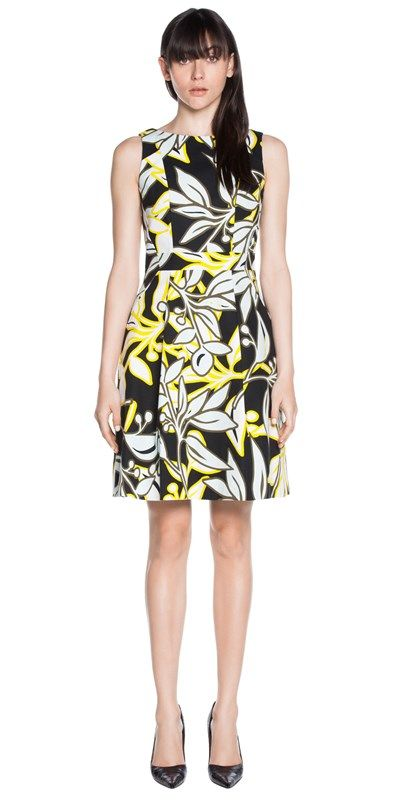 Made from floral print cotton fabric from Europe, this sleeveless dress featured a fitted bodice and a boat neckline, which splits into the back with contrast panel detail. Finished with a full, A-line skirt and shaped seaming. Fully lined, fastened with a metal zip back. Made in Australia.