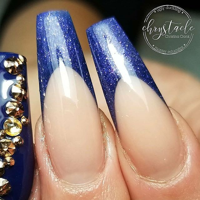 Long blue sparkly acrylic french design! Beautiful sculpted acrylic by Ugly Duckling Master Educator @chrystacle -  Ugly Duckling coloured acrylic #83 with FuFu Pink and finished with our No Wipe Top coat  Ugly Duckling Nails page is dedicated to promoting quality, inspirational nail