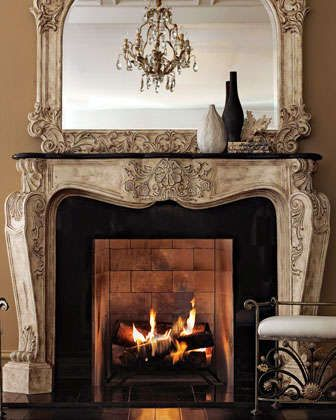 "Cast-stone mantel topped by black stone. Mantel has an antique-parchment finish with golden highlights on a shell and foliage motif. Exterior: 72""W x 14""D x 52.5""T; interior: 49.5""W x 14""D x 39.5""T. I"