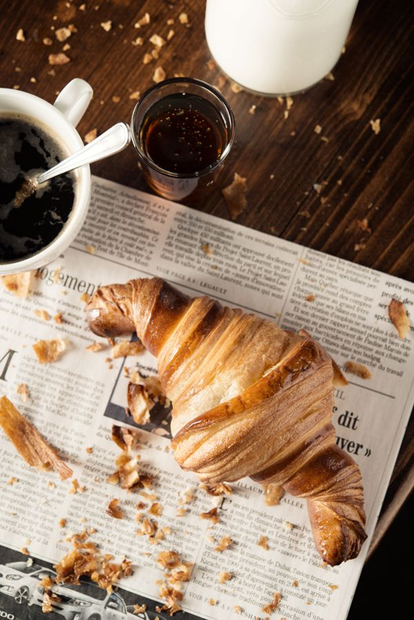 Evidence of a really flaky croissant to go with the morning coffee and paper