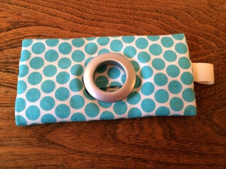 Dog Poop Bag Dispenser | Sewing project for doggie gear | dispenser right side out Supplies: 1/3 yd fabric curtain grommets snap, button, or Velcro scissors ribbon carabiner template