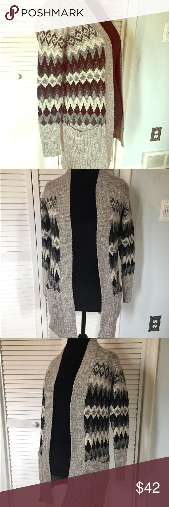 "EUC American Eagle Gray Tribal Print Cardigan EUC American Eagle Gray Tribal Print Cardigan. This long open Cardigan measures 30"" from shoulder to hem. The gray and black tribal print is on trend and the large front pockets are a nice feature. Very warm and comfortable and in great condition. Size XS but fits more like a Small to medium. American Eagle Outfitters Sweaters Cardigans"