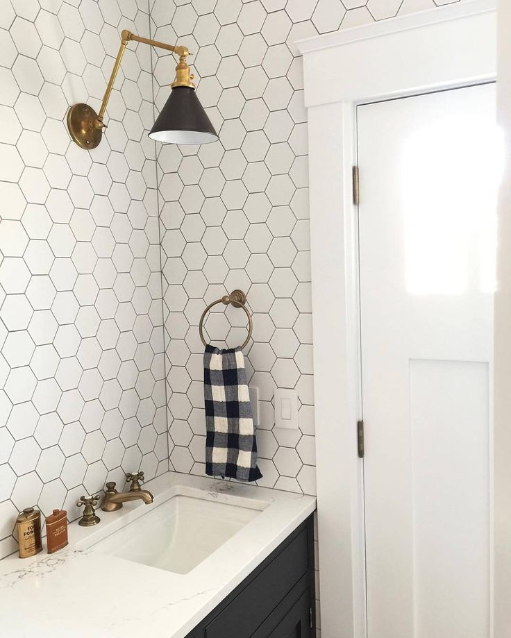 This bathroom beauty (via @caitlinwilsondesign) #princetonsconce #vintagechecktowel #schoolhouseelectric