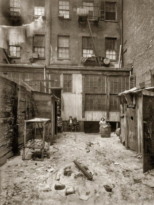 """February 1912. """"Rear view of tenement, 134½ Thompson Street, New York City. Makers of artificial flowers live and work here."""" Photograph and caption by Lewis Wickes Hine."""