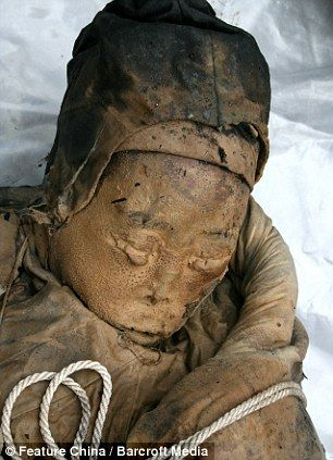 She's aged well: Face of incredibly preserved 700-year-old mummy found by chance by Chinese road workers