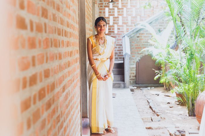 When it comes to South Indian Weddings, the beauty lies in their simplicity  - the thoranams, the tharavaad style decor and the marigolds used sparingly. The brides modern blouse on a kasavu sari, and the pretty cane umbrellas used for their entries all added to the rustic charm of this quaint affai