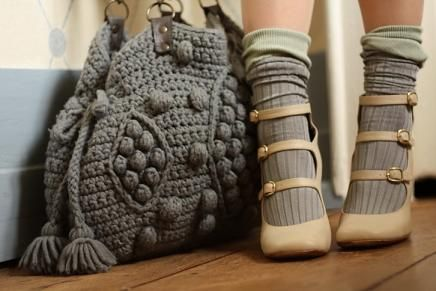 cream heels shoes and grey ribbed knit socks and a knitted bag