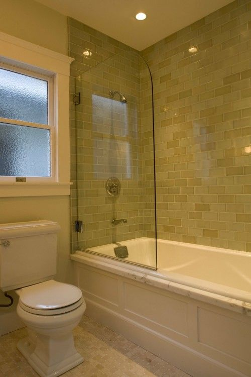 Not a fan of the subway tile but like the high walls of the bathtub, glass divider and that the tiles go all the way to the ceiling.