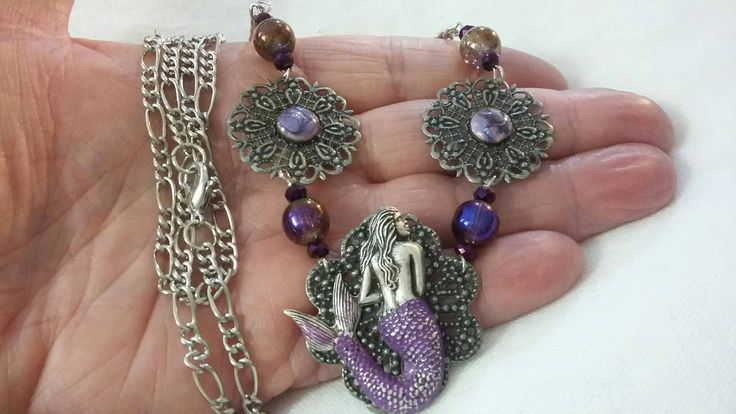 Pretty in Purple, the latest addition to my #etsy shop: Brushed Silver Filigree Mermaid with Purple Copper Enamel Stones. #purplemermaidnecklace #silversirennecklace #renfairejewelry #copperenamel #mermaid #purplemermaid http://etsy.me/2Ec0MqE