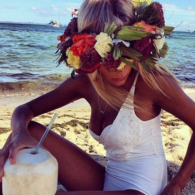 Boho chic bathing suit with modern hippie flower head band and summer coconut drink. For the BEST Bohemian fashion trends FOLLOW http://www.pinterest.com/happygolicky/the-best-boho-chic-fashion-bohemian-jewelry-gypsy-/ now