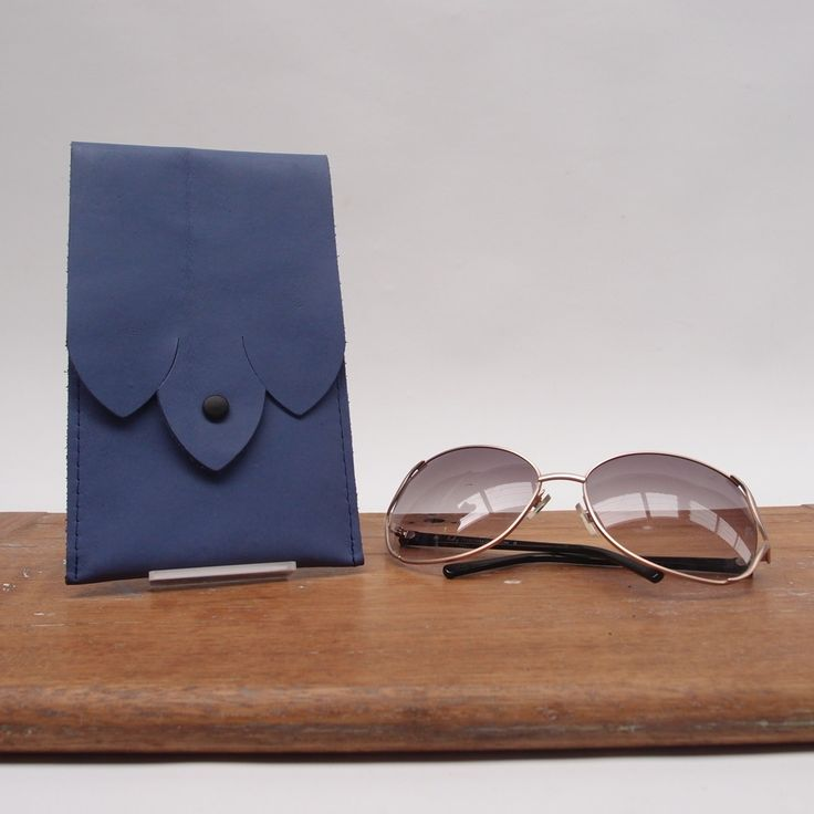 The All Leather glasses case is the perfect home for your petite reading glasses or Jackie O Sunglasses. Secures with a gentle push button snap.Measures11cm wide18cm tallLEATHER NOTES Anilene Leather is dyed vegtable tanned leather, but has no protective urethane top coat, it has a water based soil-resistant finish done during tanning. This finish can be renewed to prolong the beauty and softness of this type of leather. This leather requires some care to avoid perma...
