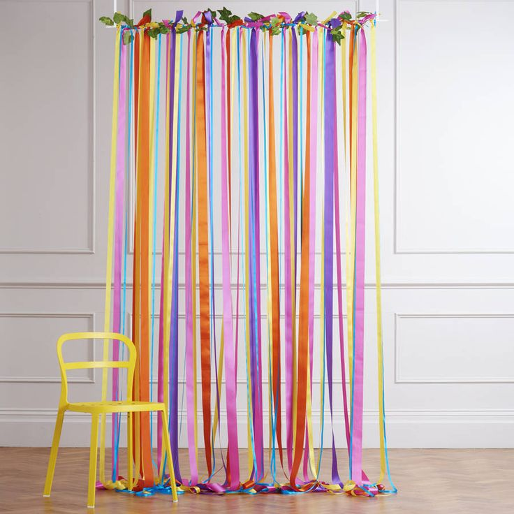 Are you interested in our rainbow wedding backdrop? With our hanging ribbon curtain you need look no further.