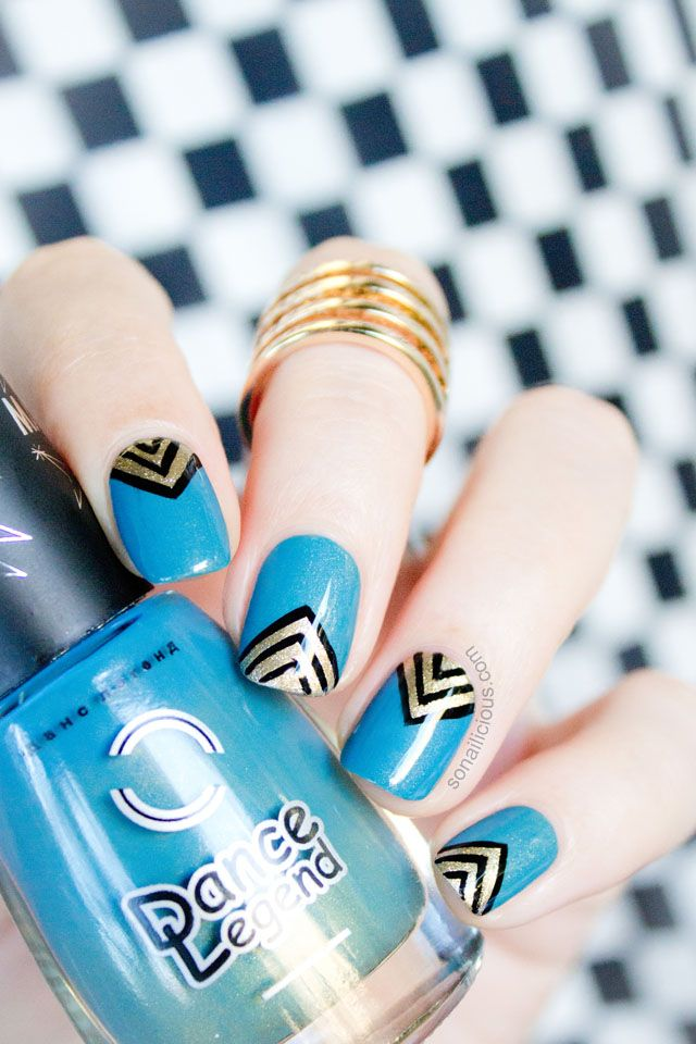 Teal and Gold Nails. Click for nail art details.