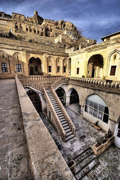 Mardin, Turkey: The town is located on the slope of a hill looking down south to the Mesopotamian plains. Mardin is on the rail and highway routes connecting Turkey to Syria and Iraq. According to a hearsay, the history of the city dates as far back as the Flood.
