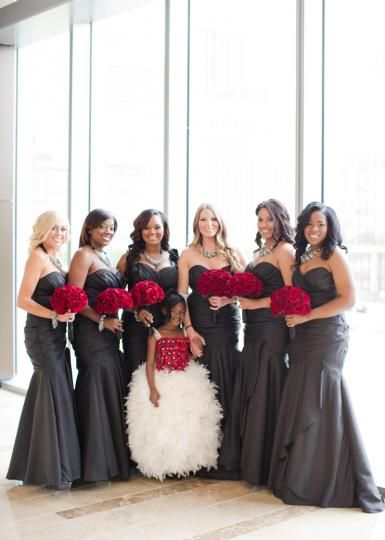 Glam bridesmaids in charcoal grey dresses with red rose bouquets. Wedding by Crystal Frasier Weddings. Photo by Thisbe Grace Photography. #wedding #bridesmaids #grey