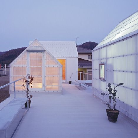 The top floor rooms of this house in Japan by Tato Architects are contained inside sheds that sit on the roof.