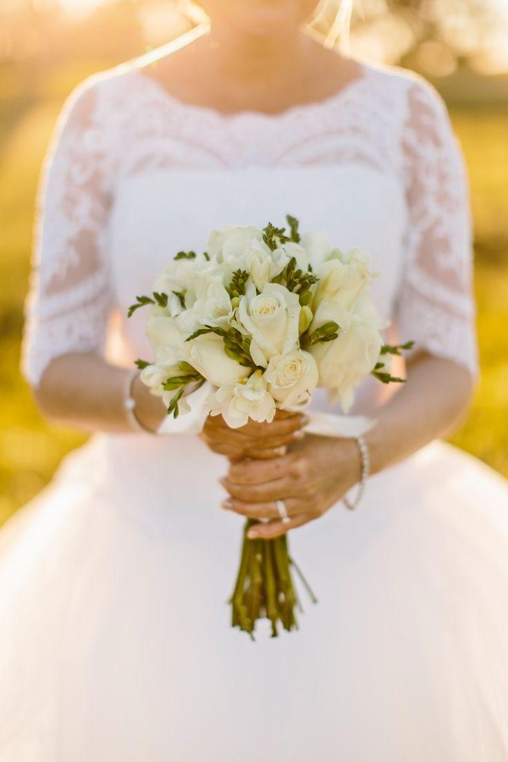 Simple white rose wedding bouquet. Image: Cavanagh Photography. http://cavanaghphotography.com.au