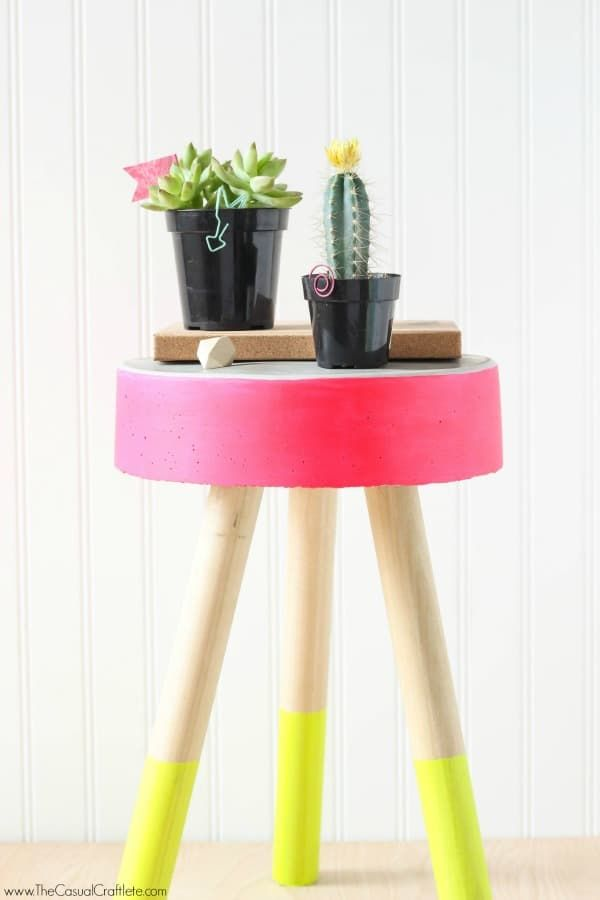Constructed from wooden dowels and concrete, this adorable three-legged stool looks surprisingly easy to make. The added neon paint colors truly make it a one-of-a-kind item that you just can't ignore. Check out the DIY how-to!