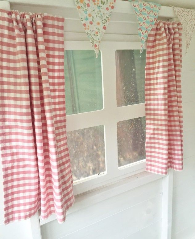 Hand-made playhouse curtains in Amelia's Waltons Playhouse