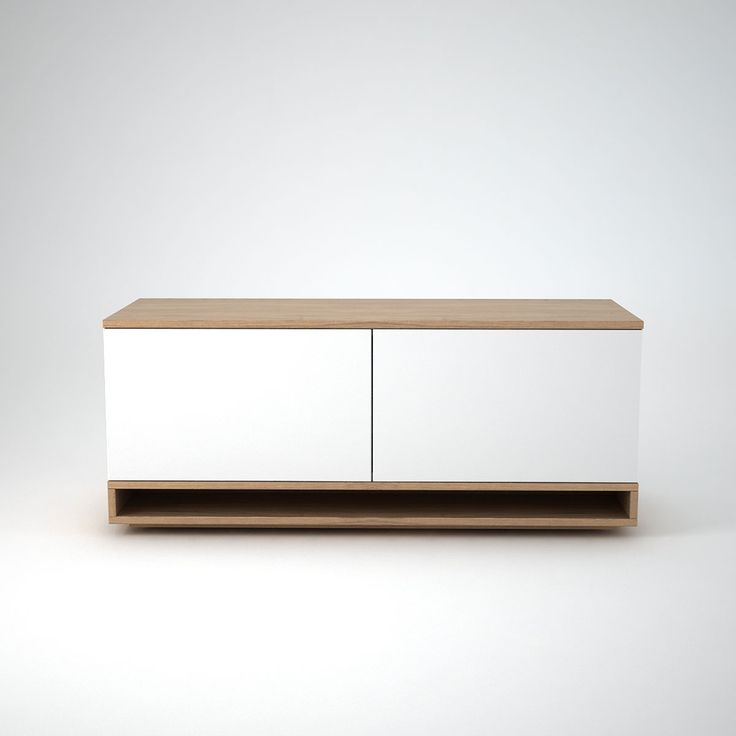 This smaller version of our Low Contemporary Sideboard, Harlem is characterised by its sleek leg feature. This smaller size version with 2 push release doors is ideal for spaces such as alcoves. The combination of white matt wood composite and warm soft Oak creates a classically modern sideboard style.  NB:Rear cable management holes are available on request.  Size: 1000mm or 1200mm Wide. 455mm Deep x 485mm high Bespoke sizes available on request – please contact us with your requirements.