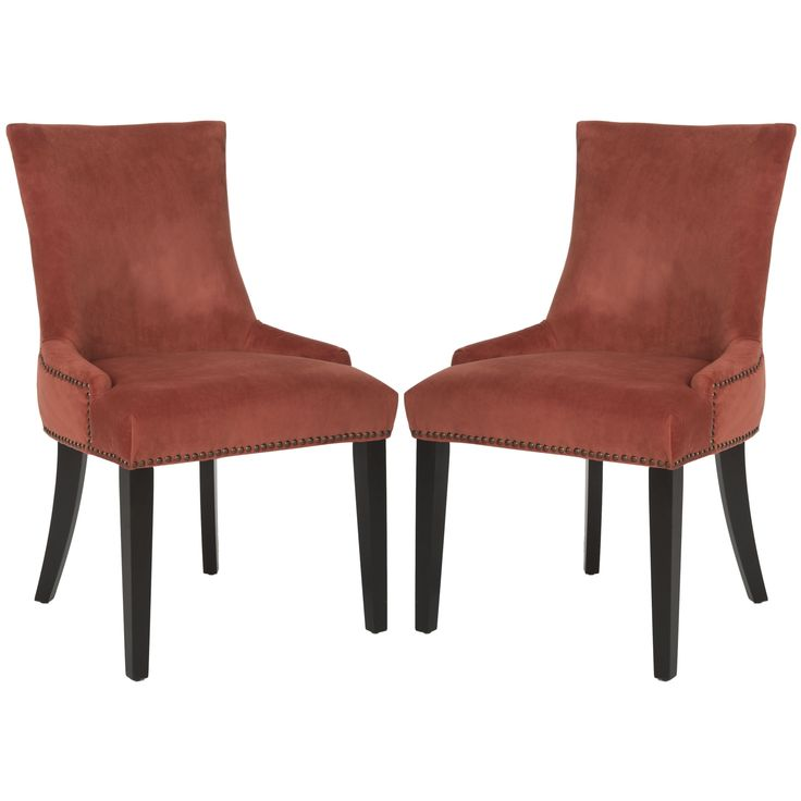 Low sloped arms and a slight hourglass shape to the seat back define this set of two dining chairs upholstered in cotton velvet in rust.