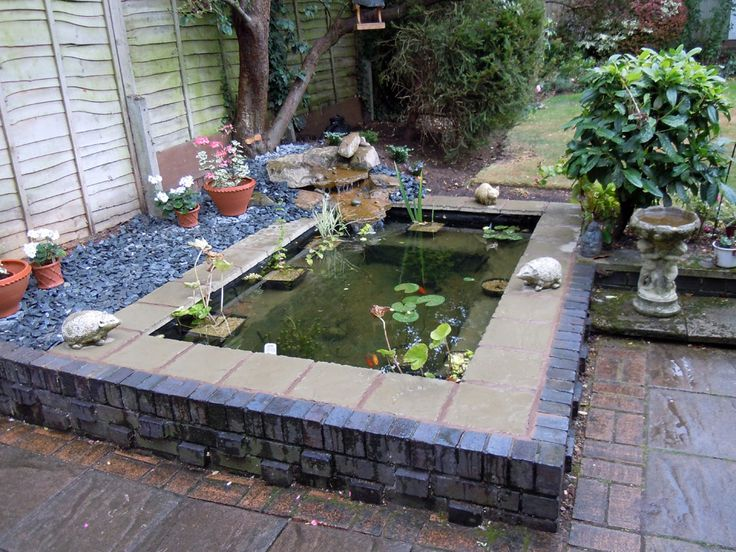 Garden pond this is a formal pond slightly raised with for Garden pond overflow design