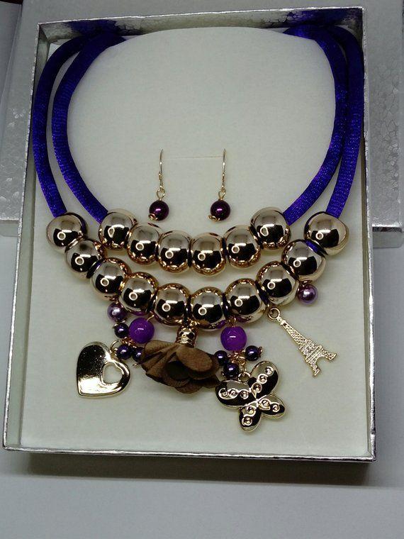 78e89773cbf0 Collar babero de cordón dijes y flores | Pulseras | Collares babero ...