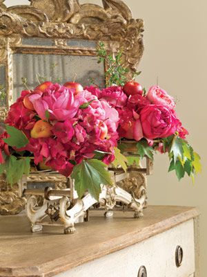 Pink garden roses, hydrangeas and huckleberry branches with the addition of crabapples and maple foliage ornament an already ornamental antique French scale.