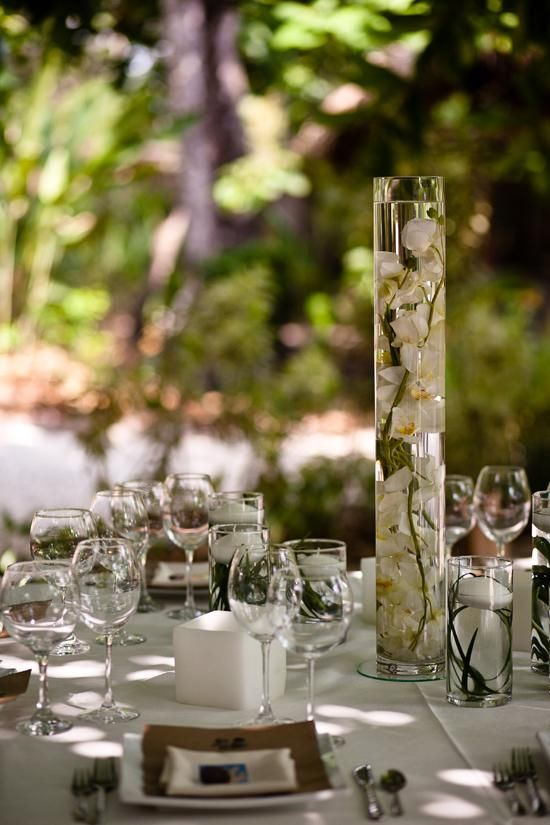 Tall centerpieces with submerged orchids