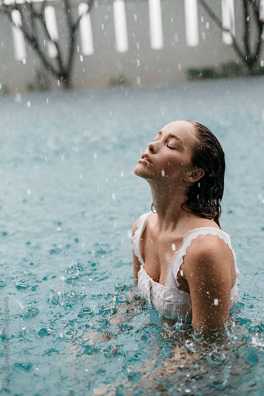 woman in a pool swimming in the rain by Jessica Sh…