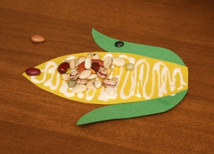 Corn Craft. Comes with a template! Using popcorn instead of dried beans.