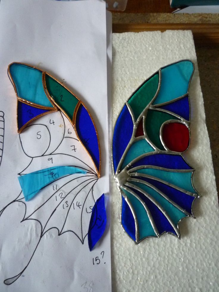 stained glass butterfly - could have 2 sided swinging door, each with a butterfly wing and the latch being a body