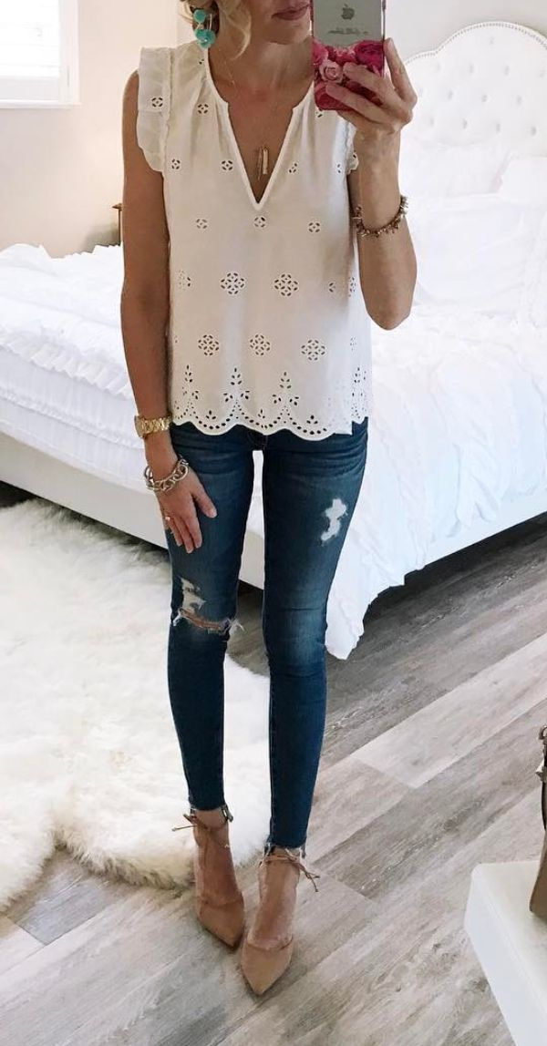 Like the clean look of this white sleeveless top and the unique style of it.