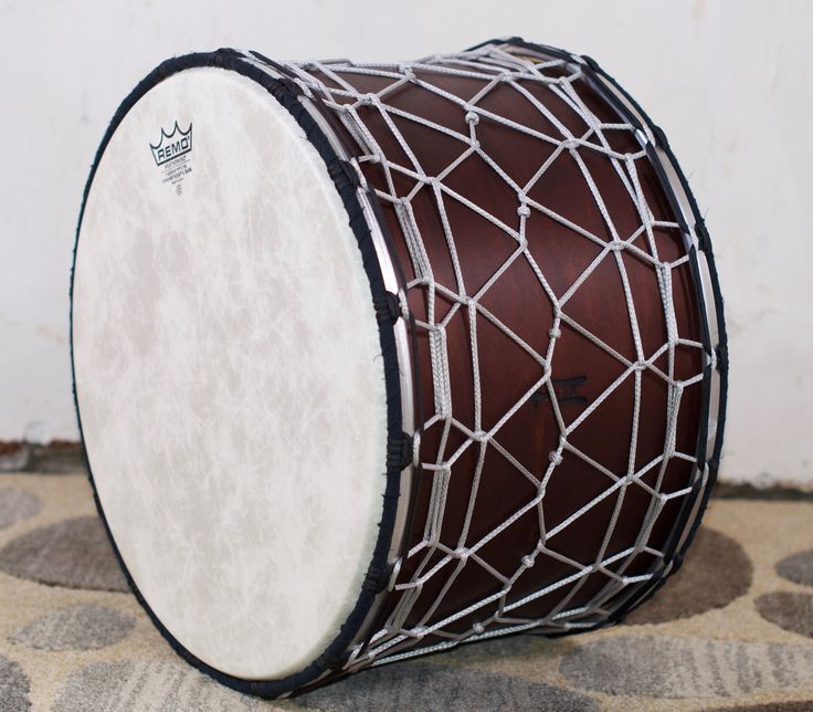 https://flic.kr/s/aHskwn9voq | Introducing another first for TreeHouse: Independent tuning on an all rope-tuned drum!  Complete with the highest highs and lowest lows, this Tupan is flexible enough to keep the beat in any musical style. 14x18; plied maple; satin wax.  To see more pix, and search our entire TreeHouse archive for your favorite specs, visit our photo gallery: http://www.flickr.com/photos/treehousedrums/collections/