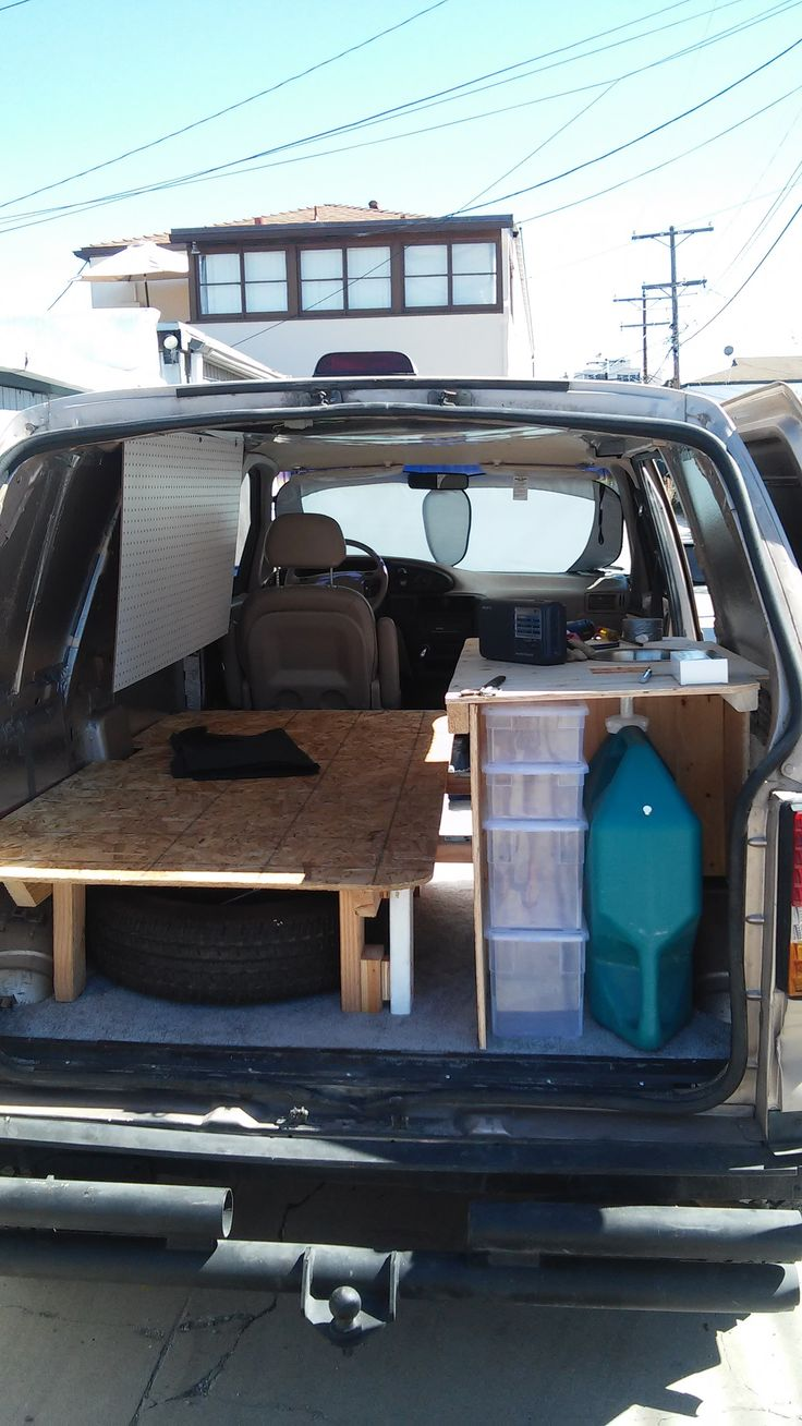Ford aerostar suv camping campers truck gold rolling shelter gizmag s favorite campers of 2013