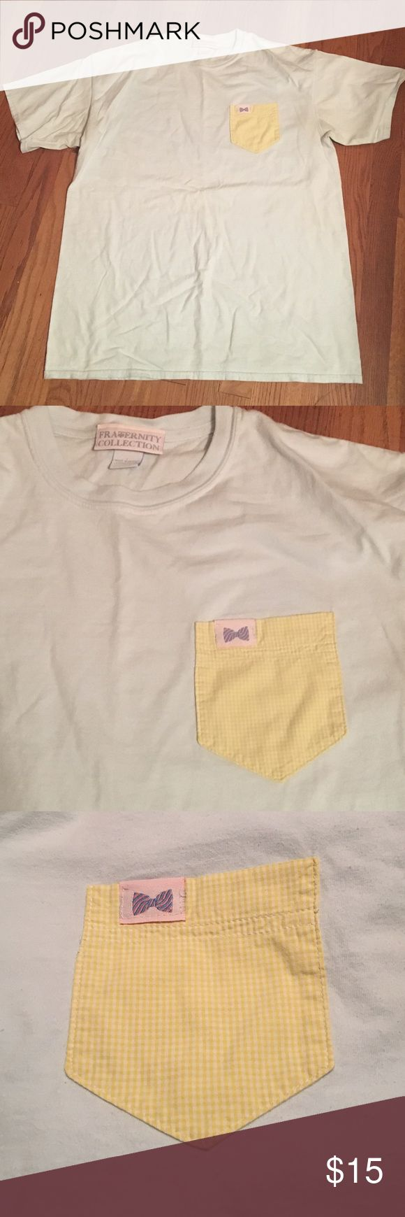 Frat Collection Pocket Tee Ladies Fraternity Collection Pocket Tee. Light Blue Tshirt with yellow check Pocket. Excellent used condition! Smoke free home. Fraternity Collection Tops Tees - Short Sleeve