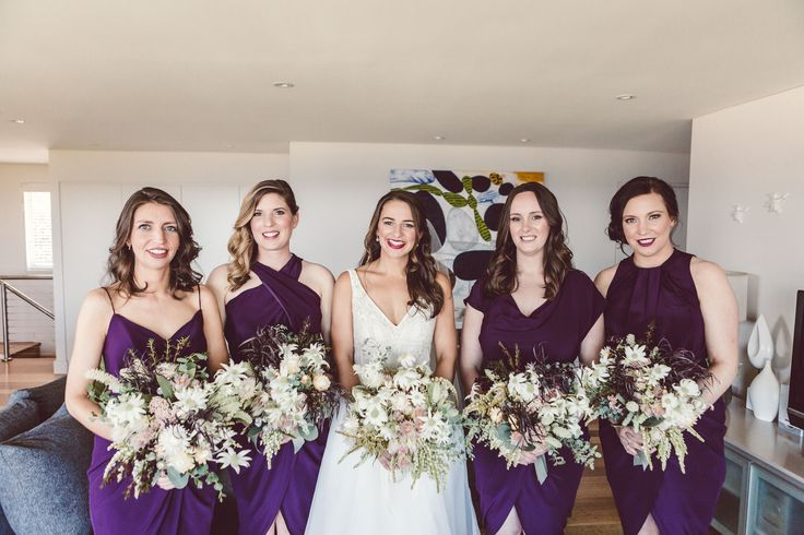 Bridal and bridesmaids bouquets by Shady Fig using a native mix of flannel flowers, blushing brides, paper daisy and more. Photographed by Red Berry Photography.