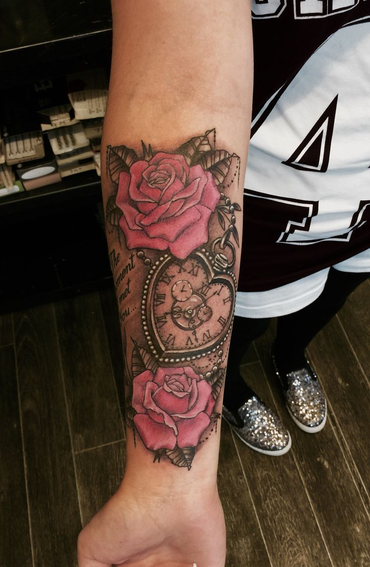 Arm Tattoos -                                                              Heart shaped pocket watch and roses tattoo
