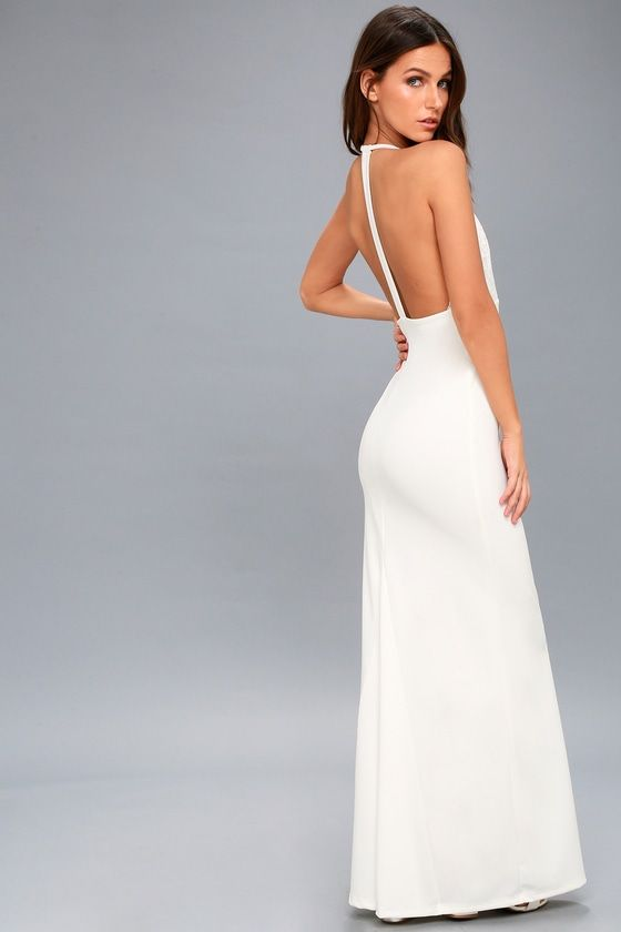 Live the life of a red carpet queen in the Prima Donna Life White Lace Backless Maxi Dress! Stunning floral lace decorates a dramatic plunging neckline atop an empire waist, and mermaid maxi skirt. Adjustable skinny straps creates a T-strap across a daring open back.