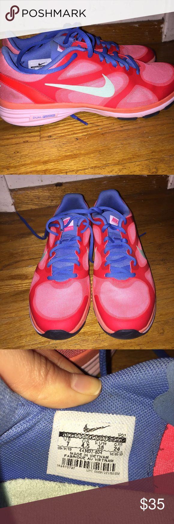 Pair of Nike Dual Fusion Sneakers Pair of Nike dual fusion sneakers. Very good condition. Only wore once indoors. Nike Shoes Sneakers