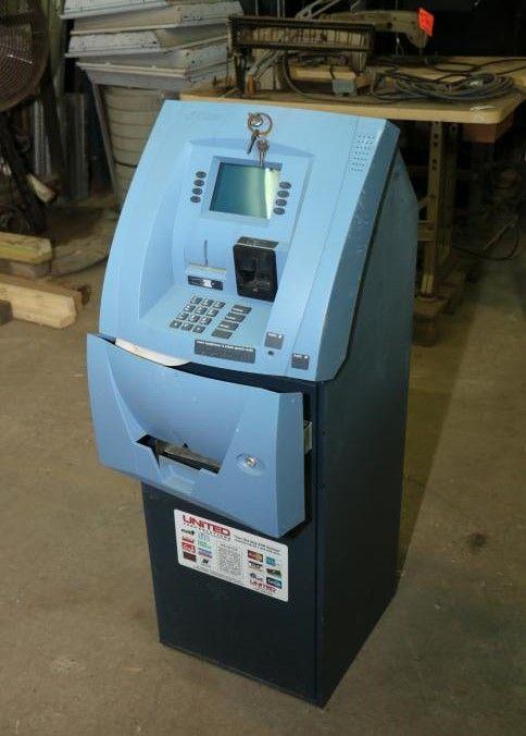 "Item # 5 -- Triton ATM machine 17""x19""x49 25""T  Includes"