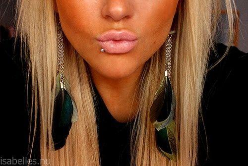 Lip piercing. earrings. Hair. tanness. yup.