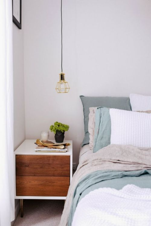clear white, grey and blue bedroom with brown bedside cabinet