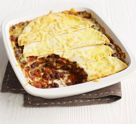 Mexican bake. Raid your storecupboard and try out this fresh idea for canned beans with fajita spices - top with tortillas and cheese.